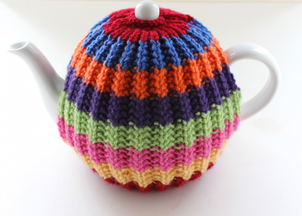 Hand Knitted Rainbow Tea Cosy In Pure Wool For 6 Cup Teapots By